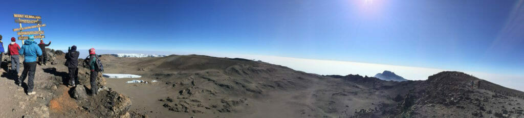 Looking out over the 2.5km caldera of Uhuru Peak. In the caldera you can see the melting remnants of the Furtwangler Glacier, the Inner Cone and Reusch Crater with he Northern Ice Field in the distance.